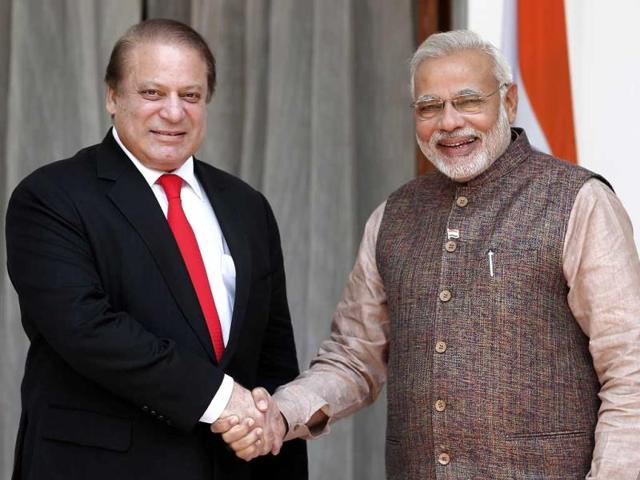 PM-Narendra-Modi-shakes-hands-with-his-Pakistani-counterpart-Nawaz-Sharif-in-New-Delhi-Reuters