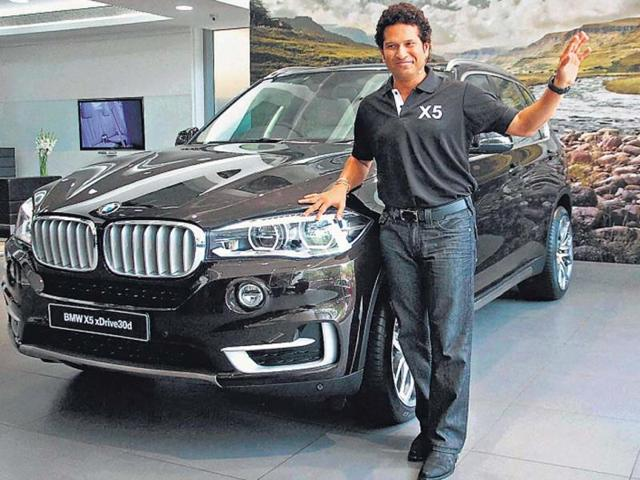BMW-s-India-brand-ambassador-former-cricketer-Sachin-Tendulkar-poses-with-the-made-in-India-SUV-X5xDrvie-which-costs-Rs-10-lakh-less-than-the-outgoing-version-India-is-the-fifth-market-after-US-Russia-Malaysia-and-Thailand-to-get-the-X-series-which-is-not-available-in-Europe-including-Germany-The-car-is-being-made-at-BMW-s-Chennai-plant-Photo-PTI