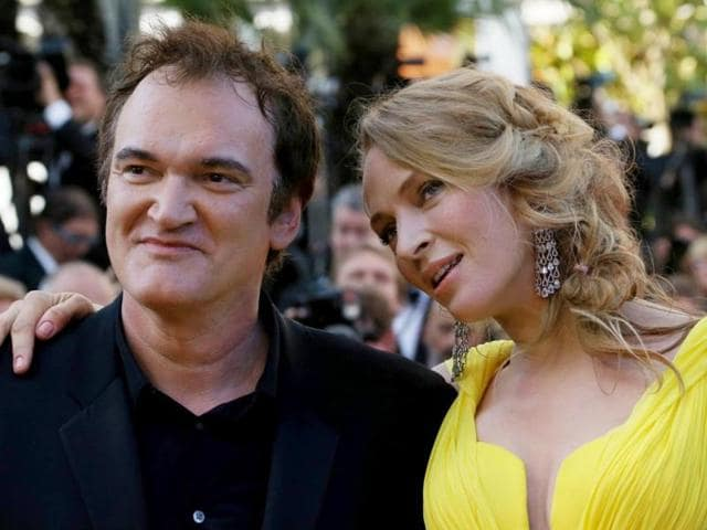 Hollywood-actor-Uma-Thurman-and-director-Quentin-Tarantino-pose-as-they-arrive-for-the-screening-of-the-film-Sils-Maria-at-the-67th-edition-of-the-Cannes-Film-Festival-AFP-Photo
