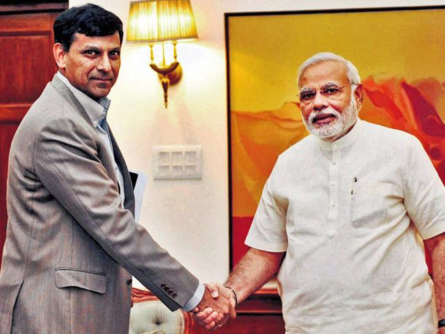 Prime-Minister-Narendra-Modi-with-Governor-of-Reserve-Bank-Raghuram-Rajan-at-7-Race-Course-Road-in-New-Delhi-PTI-Photo