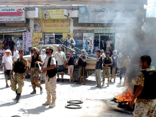 Army-soldiers-stand-near-burning-tires-by-Yemenis-demanding-more-compensation-for-their-losses-during-fights-against-al-Qaeda-militants-in-Abyan-province-Yemen-on-Tuesday-Reports-state-dozens-of-Yemenis-took-to-the-streets-in-Abyan-south-Yemen-in-protest-the-government-s-refusal-to-compensate-them-for-their-homes-and-properties-which-had-been-destroyed-during-fights-between-the-Yemeni-army-and-al-Qaeda-militants-EPA-Photo
