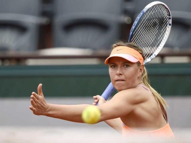 Russia-s-Maria-Sharapova-returns-to-Spain-s-Garbine-Muguruza-during-their-French-tennis-Open-quarter-final-match-at-the-Roland-Garros-stadium-in-Paris-AFP-Photo