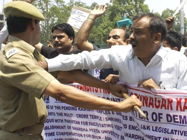 A-Policeman-stops-Kashmiri-Pandits-as-they-protest-against-the-government-in-Srinagar-on-Wednesday-Waseem-Andrabi-HT