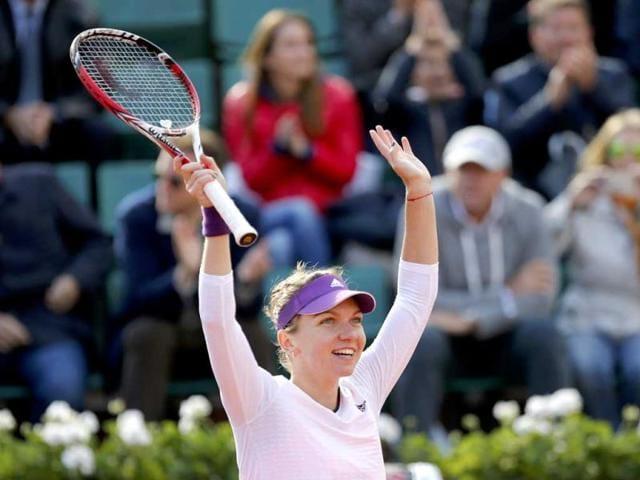 Simona-Halep-of-Romania-celebrates-after-winning-her-women-s-quarter-final-match-against-Svetlana-Kuznetsova-of-Russia-at-French-Open-tennis-tournament-at-the-Roland-Garros-stadium-in-Paris-Reuters-photo