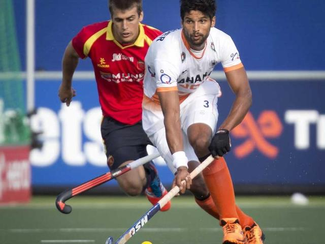 India-s-Rupinder-Singh-R-and-Spain-s-Alex-Casasayas-battle-for-the-ball-during-their-Hockey-World-Cup-match-in-The-Hague-Netherlands-EPA-Photo