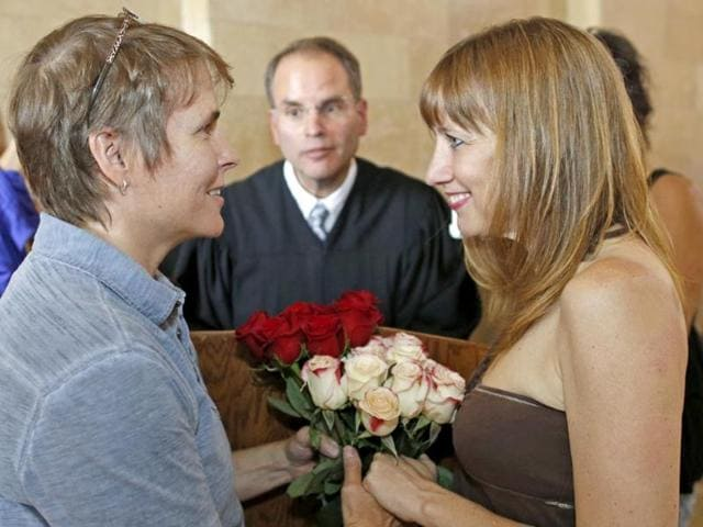 Pat-Cline-left-and-Patty-McKenzie-look-at-each-other-during-their-wedding-at-the-Milwaukee-County-Courthouse-in-Milwaukee-AP-Photo