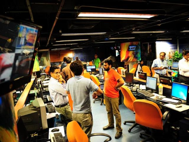 Pakistani-journalists-gather-in-the-newsroom-of-Geo-television-in-Karachi-after-Pakistan-took-the-country-s-most-popular-television-channel-off-air-AFP-Photo