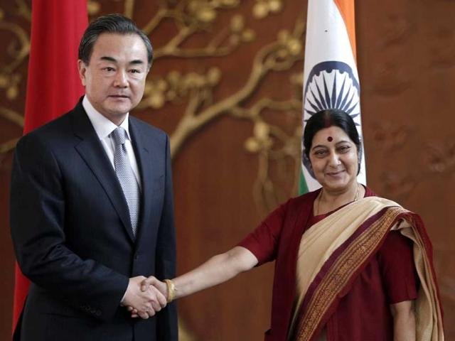 Chinese-Foreign-Minister-Wang-Yi-shakes-hands-with-his-Indian-counterpart-Sushma-Swaraj-before-their-meeting-in-New-Delhi-Reuters-Photo