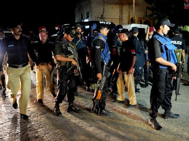 Pakistani security personnel gather outside the Jinnah International Airport after the militants