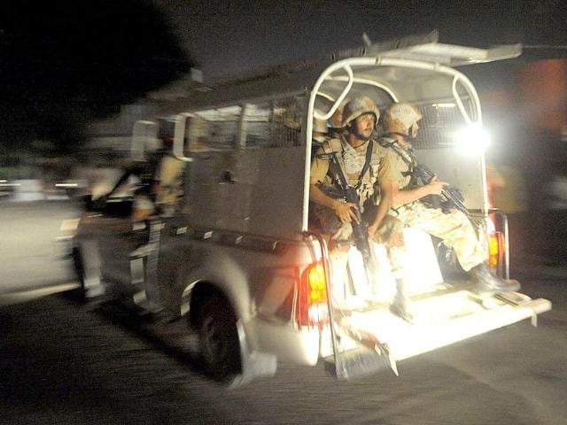 Pakistani paramiliraty soldiers rush into the Karachi airport terminal after the militants
