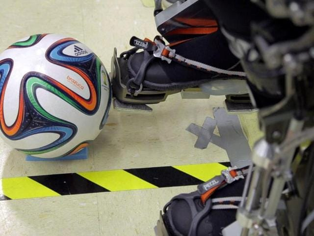 A-Brazuca-football-lying-beside-an-exoskeleton-at-Brazilian-scientist-Miguel-Nicolelis-lab-in-Sao-Paulo-Brazil-AFP-photo