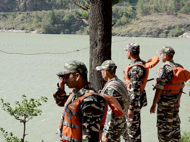 Rescue-personnel-gather-on-the-banks-of-the-Beas-river-during-a-search-operation-in-Kullu-a-day-after-24-engineering-students-of-Hyderabad-were-washed-away-AFP-Photo