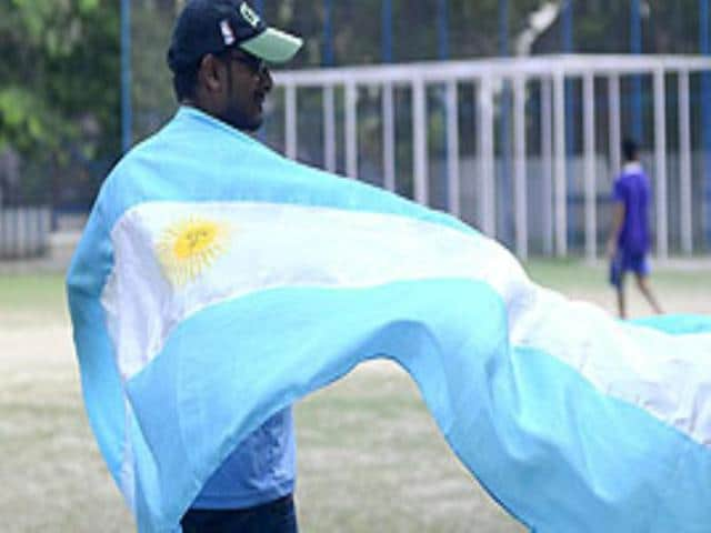 A fan stands with the Argentina flag draped over his shoulders during the FIIOB World Cup fan tournament in Salt Lake, Kolkata. (Prateek Choudhury/HT Photo)