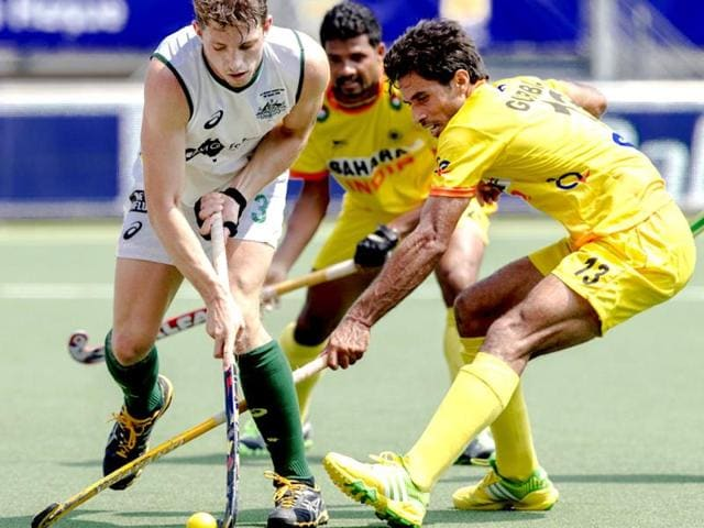 Australia-s-Simon-Orchard-L-fights-for-the-ball-with-India-s-Gurbaj-Singh-R-during-the-match-between-Australia-and-India-in-the-men-s-tournament-of-the-Field-Hockey-World-Cup-in-The-Hague-Netherlands-AFP-Photo