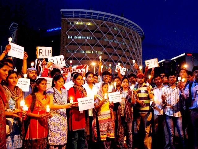 IT professionals and students in Hyderabad take part in a candle light march in memory of the 24 engineering students who were swept away in Beas River in Himachal Pradesh. (PTI Photo)