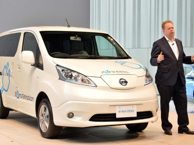 Chief-planning-officer-for-Japan-s-auto-giant-Nissan-Andy-Palmer-speaks-about-the-company-s-new-commercial-electric-vehicle-e-NV200-at-the-company-s-headquarters-in-Yokohama-suburban-Tokyo-on-June-9-2014-Nissan-will-put-the-Spanish-made-new-electric-vehicle-which-travel-190-kms-per-charge-on-to-the-Japanese-market-in-October-Photo-AFP