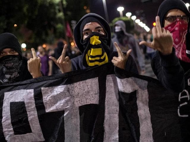 Members-of-the-anarchist-group-Black-Bloc-protest-against-the-FIFA-World-Cup-in-Rio-de-Janeiro-Brazil-Brazil-has-been-hit-by-a-wave-of-strikes-and-protests-against-the-11-billion-being-spent-on-the-tournament-in-a-country-that-desperately-needs-investment-in-health-education-and-transport-AFP-Photo