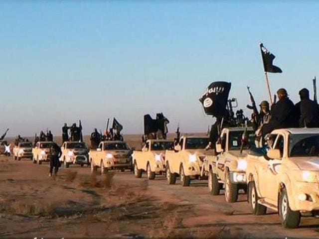 A convoy of vehicles and fighters from the al-Qaida-linked Islamic State of Iraq and the Levant (ISIL) fighters in Iraq
