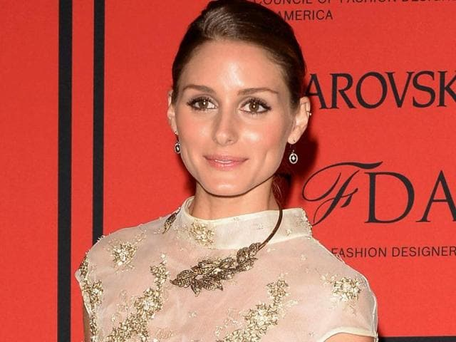 American socialite Olivia Palermo wore a simple gold choker to the CFDA Fashion Awards 2014 in New York.