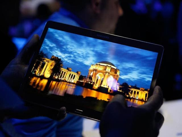 A-member-of-the-media-tries-out-a-new-Samsung-Galaxy-Tab-S-after-the-tablet-s-debut-at-a-press-conference-in-New-York-Photo-AP-Kathy-Willens