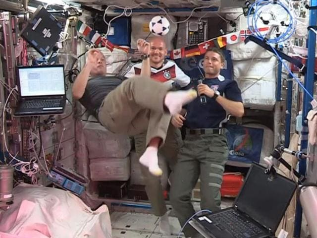 United-States-astronauts-Steve-Swanson-L-Reid-Wiseman-R-and-German-astronaut-Alexander-Gerst-kick-around-a-football-some-230-miles-above-Earth-aboard-the-International-Space-Station-AP-Photo