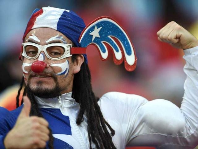 A Chilean football fan cheers for his team before the match between Chile and Australia.(AFP Photo)