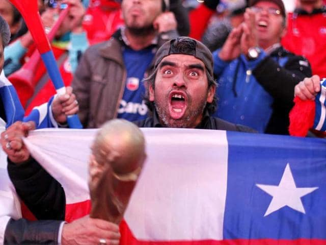 Chilean fans celebrate their team's victory over Australia.(EPA photo)