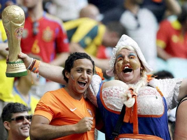 Dutch fans cheer their team before the match between Spain and the Netherlands. (AP photo)
