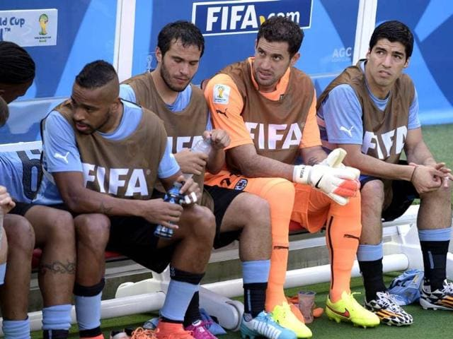 Uruguay-s-forward-Luis-Suarez-extreme-right-goalkeeper-Martin-Silva-second-from-right-and-other-players-sit-on-the-substitutes-bench-during-the-Group-D-match-between-Uruguay-and-Costa-Rica-at-the-Castelao-Stadium-in-Fortaleza-AFP-Photo