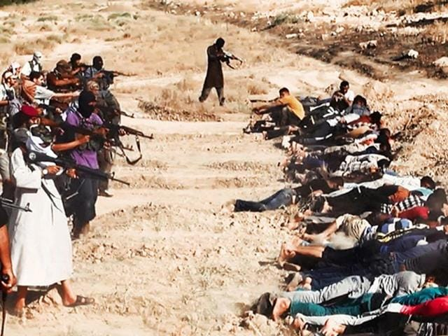 This image posted on a militant website on Saturday, which has been verified and is consistent with other AP reporting, appears to show militants from the al Qaeda-inspired Islamic State of Iraq and the Levant (ISIL) taking aim at captured Iraqi soldiers wearing plain clothes after taking over a base in Tikrit, Iraq. (AP Photo via militant website)