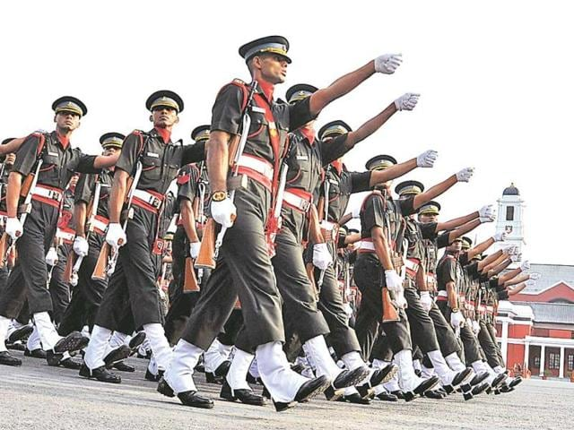 Cadets perform march past during the passing out parade at IMA in Dehradun on Saturday.