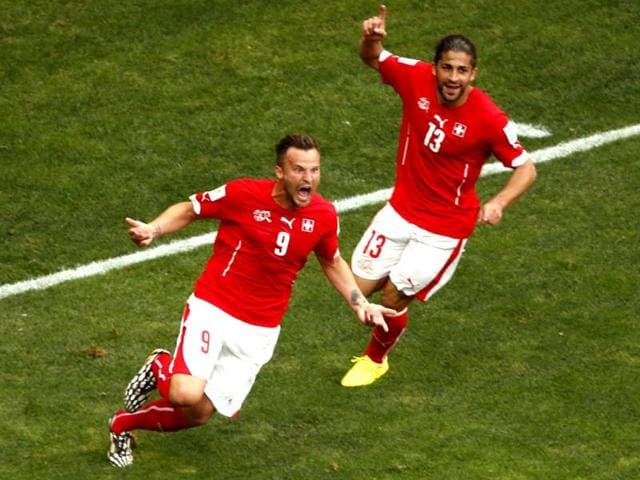 Switzerland-s-Haris-Seferovic-celebrates-after-scoring-a-goal-with-Ricardo-Rodriguez-during-the-2014-World-Cup-Group-E-match-between-Switzerland-and-Ecuador-at-the-Brasilia-national-stadium-in-Brasilia-Reuters