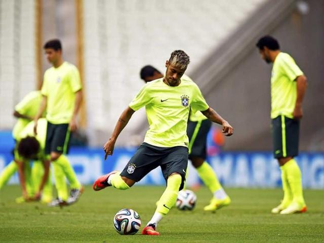 Brazil-s-star-player-Neymar-kicks-the-ball-during-a-training-session-in-Fortaleza-Brazil-will-face-Mexico-in-their-second-Group-A-match-of-the-2014-World-Cup-in-Brazil-Reuters-Photo