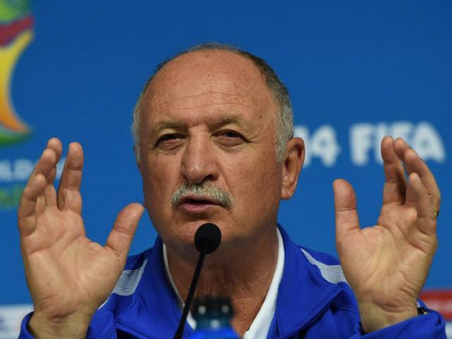 Brazil-s-coach-Luiz-Felipe-Scolari-L-speaks-as-defender-and-captain-Thiago-Silva-R-listens-during-a-press-conference-at-Mineirao-stadium-in-Belo-Horizonte-AFP-Photo