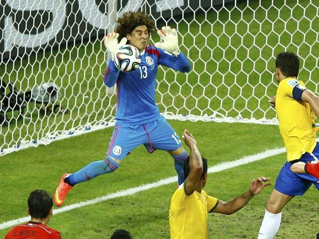 Mexico-s-Guillermo-Ochoa-L-deflects-the-ball-during-a-goal-attempt-by-Brazil-s-Thiago-Silva-top-R-during-their-World-Cup-Group-A-match-at-the-Castelao-arena-in-Fortaleza-Reuters-Photo
