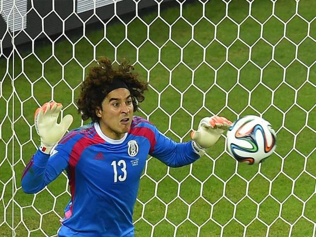 Mexico-s-Guillermo-Ochoa-L -deflects-the-ball-during-a-goal-attempt-by-Brazil-s-Thiago-Silva-top-R-during-their- World-Cup-Group-A-match-at-the-Castelao-arena ... a59ca6561