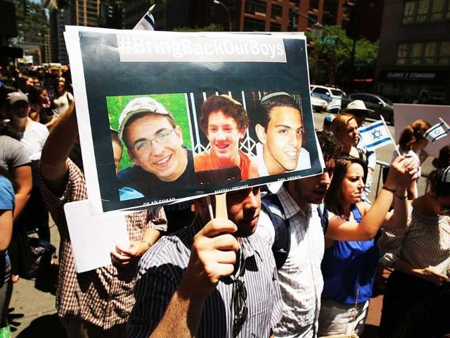 People-gather-for-a-vigil-for-the-three-missing-Israeli-teens-outside-of-the-Israeli-Consulate-in-New-York-City-Spencer-Platt-Getty-Images-AFP