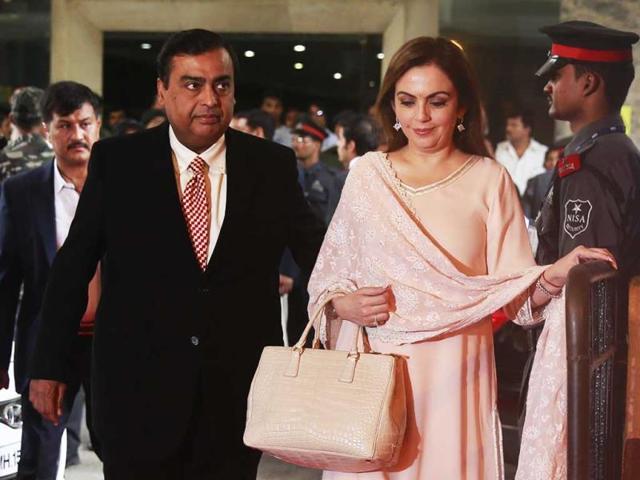 Reliance-Industries-chairman-Mukesh-Ambani-left-and-his-wife-Nita-Ambani-arrive-for-the-company-s-annual-general-meeting-in-Mumbai-AP-Photo
