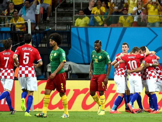 Croatian-players-celebrate-after-scoring-a-goal-during-the-Group-A-football-match-between-Cameroon-and-Croatia-at-The-Amazonia-Arena-in-Manaus-during-the-2014-Fifa-World-Cup