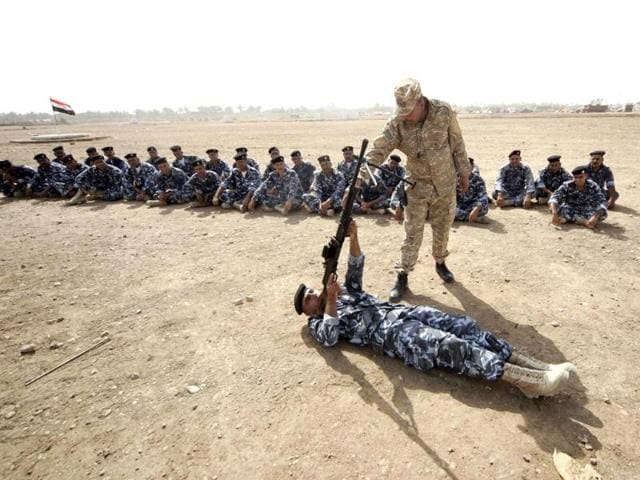 This-image-appears-to-show-ISIS-militants-leading-away-captured-Iraqi-soldiers-Foreign-fighters-from-dozens-of-nations-are-pouring-into-the-West-Asia-to-join-the-Sunni-militants--AP-PTI-Photo