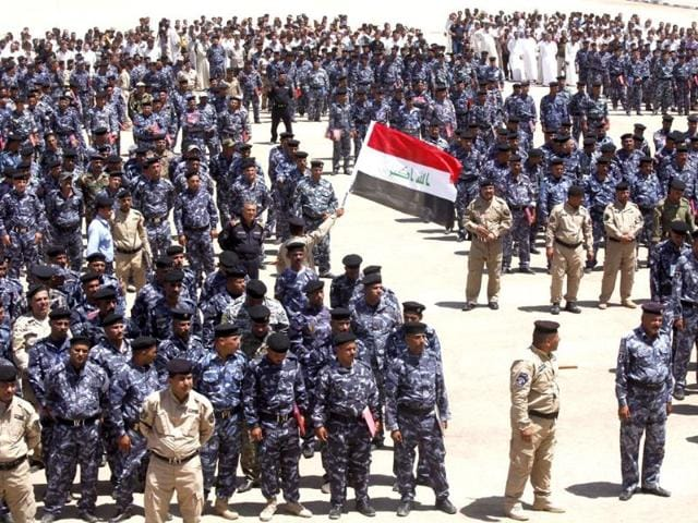 Volunteers-who-have-joined-the-Iraqi-security-forces-to-fight-against-the-predominantly-Sunni-militants-from-the-radical-ISIL-wearing-the-police-force-uniforms-gather-in-the-holy-city-of-Najaf-Reuters-Photo