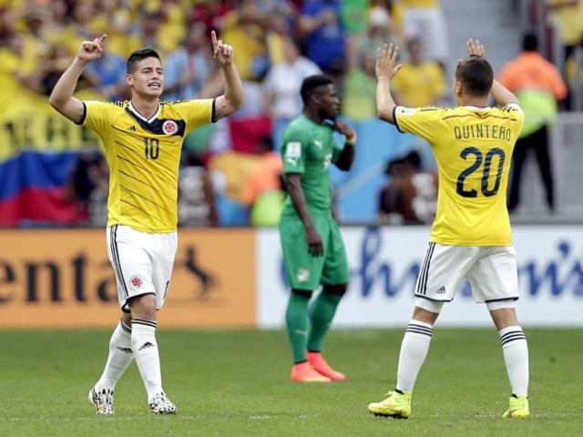 Colombia-s-James-Rodriguez-10-celebrates-with-Juan-Quintero-20-after-scoring-his-side-s-opening-goal-during-the-Group-C-World-Cup-match-between-Colombia-and-Ivory-Coast-at-the-Estadio-Nacional-in-Brasilia-AP-Photo