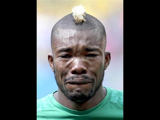 Ivory-Coast-s-Serey-Die-is-overcome-with-emotion-as-they-play-the-national-anthem-before-the-group-C-World-Cup-soccer-match-between-Colombia-and-Ivory-Coast-at-the-Estadio-Nacional-in-Brasilia-Brazil-AP-photo