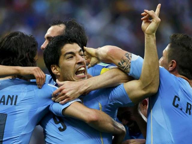 Uruguay-s-Luis-Suarez-celebrates-with-teammates-after-scoring-his-team-s-first-goal-during-their-World-Cup-Group-D-match-against-England-at-the-Corinthians-arena-in-Sao-Paulo-Reuters-Photo