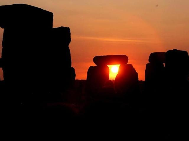 The sun rises against the Stonehenge near Salisbury, England, to celebrate the summer solstice, the longest day of the year on June 21. (AP photo)