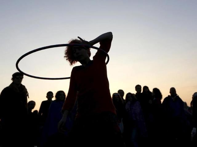 A reveler dances with a hoop as she celebrates the summer solstice at the Stonehenge. (AP photo)