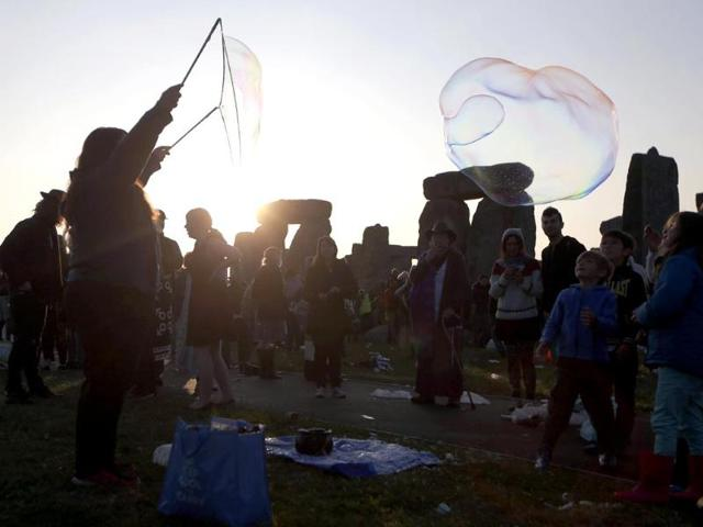 A reveler makes a giant bubble during the festivities to celebrate the longest day of the year. (Ap photo)