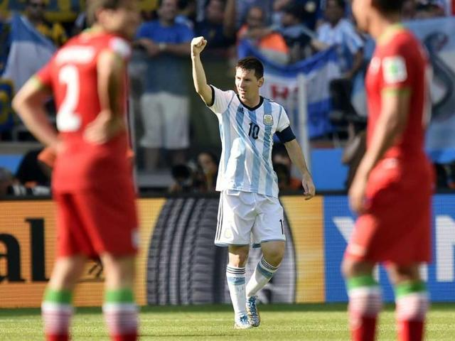 Argentina-s-Lionel-Messi-celebrates-with-his-teammates-after-scoring-his-second-goal-during-the-World-Cup-Group-F-matcha-gainst-Nigeria-at-the-Beira-Rio-Stadium-in-Porto-Alegre-AP-Photo