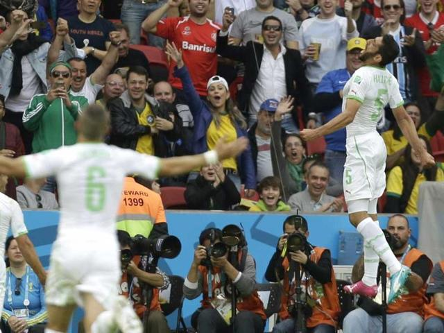 Algeria-s-Rafik-Halliche-right-celebrates-after-scoring-his-side-s-second-goal-during-the-Group-H-World-Cup-match-between-South-Korea-and-Algeria-at-the-Estadio-Beira-Rio-in-Porto-Alegre-Brazil-on-Sunday-AP-Photo
