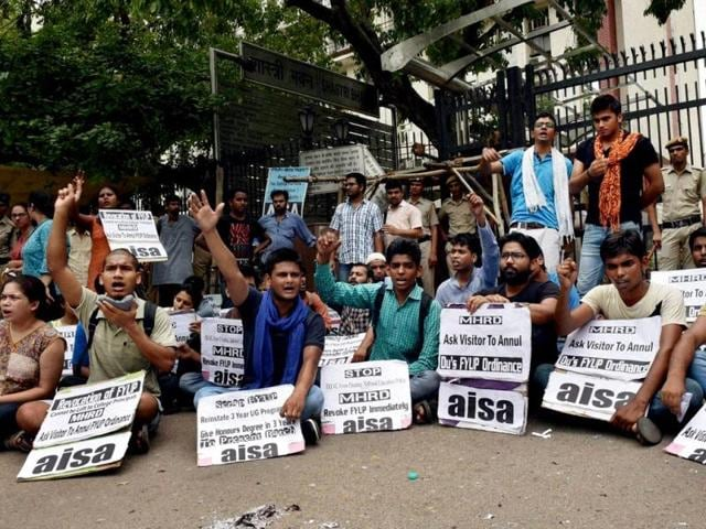 AISA activists holding a protest demanding annulment the four-year undergraduate programme (FYUP) ordinances, outside the Shastri Bhavan in New Delhi. (PTI Photo)